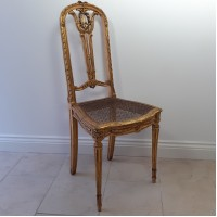 Gold bergère chair with woven cane-work